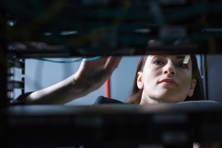 Serious beautiful technician doing her work